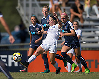 Sanford, FL - Saturday Oct. 14, 2017:  A Pride player crosses the ball while under pressure during a US Soccer Girls' Development Academy match between Orlando Pride and NC Courage at Seminole Soccer Complex. The Courage defeated the Pride 3-1.
