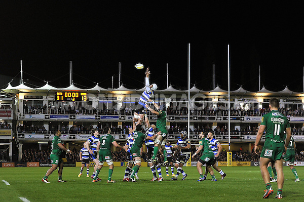 Dave Attwood of Bath Rugby rises high to win lineout ball. Aviva Premiership match, between Bath Rugby and London Irish on April 24, 2015 at the Recreation Ground in Bath, England. Photo by: Patrick Khachfe / Onside Images