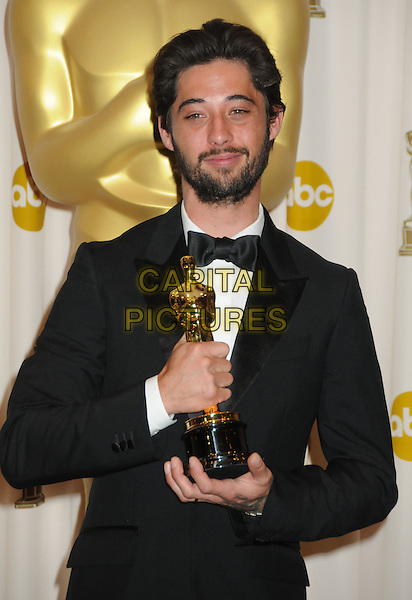 RYAN BINGHAM .82nd Annual Academy Awards held at the Kodak Theatre, Hollywood, California, USA..March 7th, 2010.oscars black tuxedo award trophy winner half length beard facial hair .CAP/ADM/BP.©Byron Purvis/AdMedia/Capital Pictures.