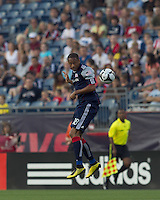 New England Revolution forward Khano Smith (18) heads the ball. The New England Revolution defeated Puebla FC in penalty kicks, in SuperLiga 2010 semifinal at Gillette Stadium on August 4, 2010.