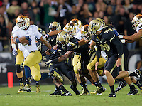 Running back George Atkinson III (4) runs back a Purdue kickoff to the Notre Dame 48-yard-line in the third quarter.
