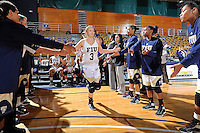 11 November 2011:  FIU's Zsofia Labady (3) is welcomed to the court prior to the game.  The FIU Golden Panthers defeated the Jacksonville University Dolphins, 63-37, at the U.S. Century Bank Arena in Miami, Florida.