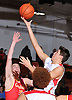 Pietro Giovanardi #12 of Long Island Lutheran, right, drives inside the paint for two points during a non-league varsity boys basketball game against Chaminade at Long Island Lutheran High School on Friday, Dec. 16, 2016.
