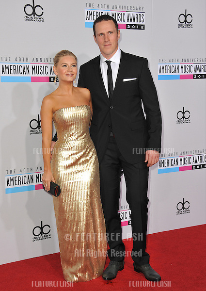 Elisha Cuthbert & Dion Phaneuf at the 40th Anniversary American Music Awards at the Nokia Theatre LA Live..November 18, 2012  Los Angeles, CA.Picture: Paul Smith / Featureflash