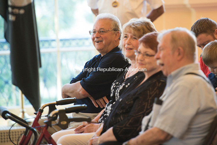WATERBURY, CT - 26 August 2015-082615EC02-- Relatives of Vincent J. DiDominzio, Sr., a WWII veteran, sit in on a Congressional medal presentation at Waterbury City Hall Wednesday night. DiDominzio, Sr. posthumously received the Bronze Star, the Purple Heart, the Good Conduct Medal and the American Campaign Medal from Congresswoman Elizabeth Esty. DiDominzio's son is sitting on the far left of the photo. Vincent DiDominzio, Jr. took the medals on his father's behalf. Congresswoman Elizabeth Esty helped secure the medals. Erin Covey Republican-American.