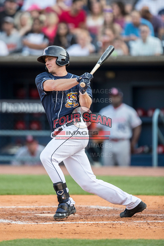 Toledo Mud Hens first baseman John Hicks (9) follows through on his swing against the Louisville Bats during the International League baseball game on May 17, 2017 at Fifth Third Field in Toledo, Ohio. Toledo defeated Louisville 16-2. (Andrew Woolley/Four Seam Images)