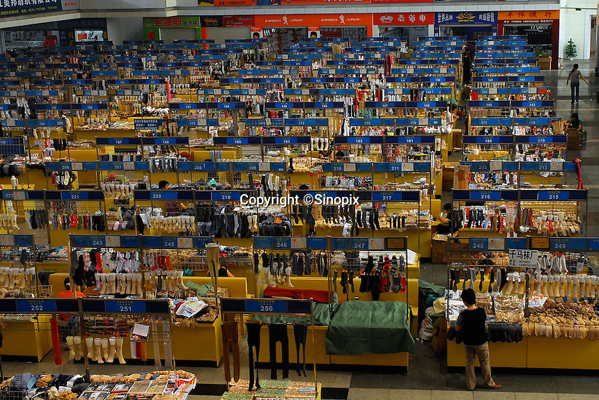"The sock trading market at ""Datang Sock Town"" in Zhuji City Zhejiang Province, China. Most factories have a presence at this market and traders are able to come here and make orders of ten or a million pairs at a time. The town in Zhejiang Province makes more than 5.3 billion pairs of socks annually - that 2.5 pairs for every human alive. Most people in the town make a living directly connected to the sock weaving industry..14 Jun 2006."