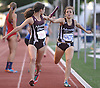 Stephanie Bazan of North Shore, left, takes the baton from teammate Morgan Nerud en route to victory in the girls' 4x800 meter relay during Day Two of the Nassau County individual championships and state qualifiers at Cold Spring Harbor High School on Friday, June 5, 2015.<br /> <br /> James Escher