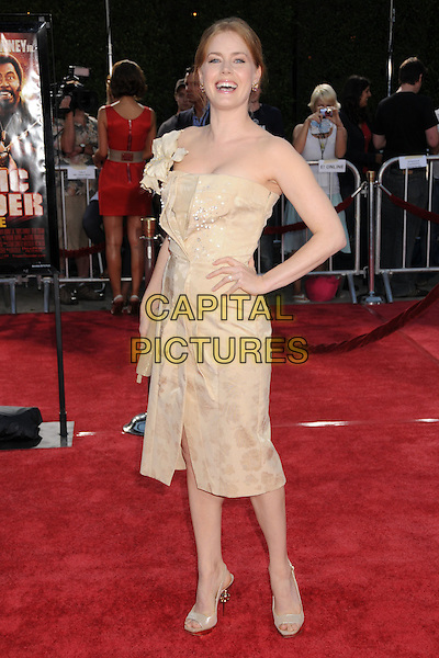 """AMY ADAMS.""""Tropic Thunder"""" Los Angeles Premiere at Mann's Village Theatre, Westwood, California, USA. .August 11th, 2008 .full length beige dress hand on hip one shoulder .CAP/ADM/BP.©Byron Purvis/AdMedia/Capital Pictures."""