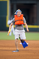 A fn competes in the flipper race between innings of the Carolina League game between the Myrtle Beach Pelicans and the Winston-Salem Dash at BB&T Ballpark on April 18, 2015 in Winston-Salem, North Carolina.  The Pelicans defeated the Dash 8-4 in game two of a double-header.  (Brian Westerholt/Four Seam Images)
