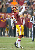 Washington Redskins place kicker Kai Forbath (2) celebrates the game-winning field goal against the Philadelphia Eagles at FedEx Field in Landover, Maryland on Saturday, December 20, 2014.  The Redskins won the game 27 - 24.<br /> Credit: Ron Sachs / CNP