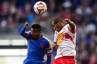 Marvin Chavez (18) of the Colorado Rapids and Roy Miller (7) of the New York Red Bulls go up for a header. The New York Red Bulls and the Colorado Rapids played to a 1-1 tie during a Major League Soccer (MLS) match at Red Bull Arena in Harrison, NJ, on March 15, 2014.