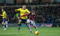 Jordan Bowery of Oxford United and Ricky Holmes of Northampton Town battle during the Sky Bet League 2 match between Oxford United and Northampton Town at the Kassam Stadium, Oxford, England on 16 February 2016. Photo by Andy Rowland.