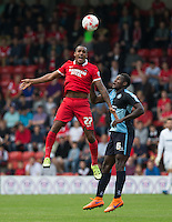 Jay Simpson of Leyton Orient beats Aaron Pierre of Wycombe Wanderers to the ball during the Sky Bet League 2 match between Leyton Orient and Wycombe Wanderers at the Matchroom Stadium, London, England on 19 September 2015. Photo by Andy Rowland.