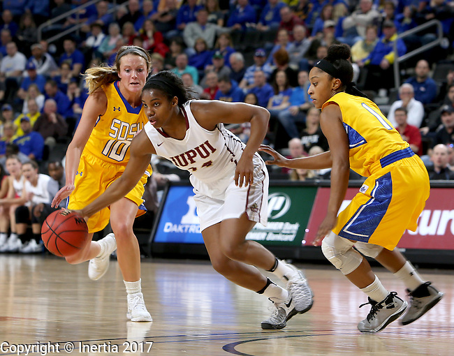 SIOUX FALLS, SD: MARCH 6: Danielle Lawrence #14 from IUPUI looks to split the defense of Kerri Young #10 and Alexis Alexander #1 from South Dakota State during the Summit League Basketball Championship on March 6, 2017 at the Denny Sanford Premier Center in Sioux Falls, SD. (Photo by Dave Eggen/Inertia)