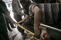 A Syrian civilian is taken into a Hospital in northeast of Aleppo City for treatment after was shot during a street fighting between reels and Assad's army.