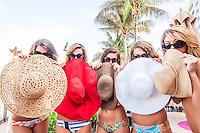 A wide assortment of hats available at Tara Grinna in Estero and taragrinna-swimwear.com, poolside at Vanderbilt Beach Resort, Naples, Florida. Photo by Debi Pittman Wilkey/Coastal Life Magazine
