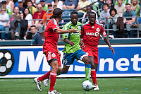 Steve Zakuani (C) of the Seattle Sounders drives between Nick Garcia (L) and Nana Attakora (R) of Toronto FC in the match at the XBox Pitch at Quest Field on August 29, 2009. The Sounders and Toronto played to a 0-0 draw.