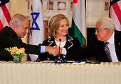 "United States Secretary of State Hillary Rodham Clinton, center, smiles as Prime Minister Benjamin Netanyahu of Israel, left, and Mahmoud Abbas of the Palestinian Authority shake hands following their remarks at the start of the ""Relaunch of Direct Negotiations Between the Israelis and Palestinians"" in the Benjamin Franklin Room of the U.S. Department of State on Thursday, September 2, 2010.  .Credit: Ron Sachs / CNP.(RESTRICTION: NO New York or New Jersey Newspapers or newspapers within a 75 mile radius of New York City)"