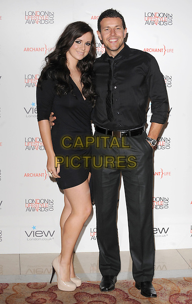 GUEST & LEE LATCHFORD EVANS.attending The London Lifestyle Awards, Park Plaza Riverbank, London, England, UK, England, 7th October 2010..full length dress couple belt  black beard facial hair tie .CAP/BEL.©Tom Belcher/Capital Pictures.