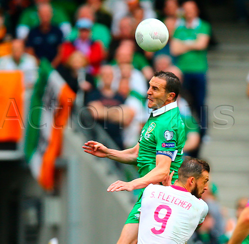 13.06.2015.  Dublin, Ireland. Euro2016 Qualifying. Republic of Ireland versus Scotland. John O'Shea (Captain Rep. of Ireland) gets up to head the ball.
