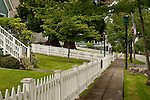Port Gamble shops along main street with hanging flowers and white picket fences