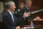 Steve Hill, with the Governor's Office of Economic Development, answers questions on the Senate floor during the second day of a special session at the Nevada Legislature, in Carson City, Nev., on Thursday, Sept. 11, 2014. Lawmakers are considering a complex deal to bring Tesla Motors to Nevada. (AP Photo/Cathleen Allison)