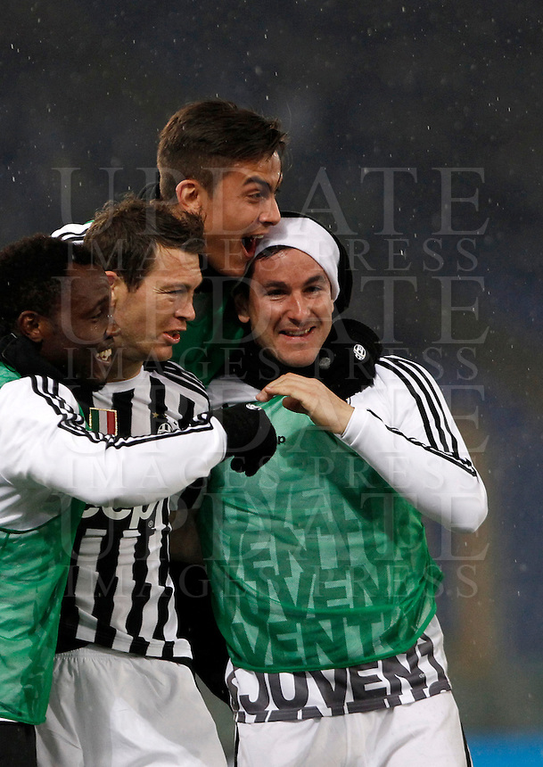 Calcio, quarti di finale di Coppa Italia: Lazio vs Juventus. Roma, stadio Olimpico, 20 gennaio 2016.<br /> Juventus' Stephan Lichsteiner, second from left, celebrates with teammates, from left, Kwadwo Asamoah, Paulo Dybala and Simone Padoin after scoring during the Italian Cup quarter final football match between Lazio and Juventus at Rome's Olympic stadium, 20 January 2016.<br /> UPDATE IMAGES PRESS/Isabella Bonotto