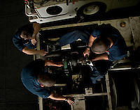 110407-N-DR144-059 ARABIAN GULF (April 7, 2011) Aviation Support Equipment Technician Airman Scott Jensen, left, Aviation Support Equipment Technician 3rd Class Peter Zavala, middle, and Aviation Support Equipment Technician Airman Jacob Ishimoto, right, all assigned to Aircraft Intermediate Maintenance Department's (AIMD) IM-4 Division, adjust the fuel injectors on a P-25 fire truck in the hangar bay of Nimitz-class aircraft carrier USS Carl Vinson (CVN 70).  Carl Vinson and Carrier Air Wing (CVW) 17 are conducting maritime security operations and close-air support missions in the U.S. 5th Fleet area of responsibility. (U.S. Navy photo by Mass Communication Specialist 2nd Class James R. Evans / Released)