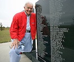 EUREKA, SD - OCTOBER 10, 2007: Al Neuharth, founder of USA Today and the Freedom Forum, poses for a photo next to the World War II Memorial that his name is inscribed on along with his brother Walter Neuharth in Eureka, SD. (Photo by Dave Eggen/Inertia/Freedom Forum)