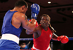 Derae Crane, left, and Cam Awesome compete in the U.S. Olympic Boxing Trials in Reno, Nev., on Wednesday, Dec. 9, 2015. (AP Photo/Cathleen Allison)