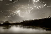 BRAZIL, Agua Boa, Amazon, Agua Boa River, lightning and rain storm in the deep Amazon jungle (B&W)