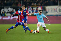 Manchester City's Kyle Walker battles for possession with Basel's Blas Riveros <br /> <br /> Photographer Craig Mercer/CameraSport<br /> <br /> UEFA Champions League Round of 16 First Leg - Basel v Manchester City - Tuesday 13th February 2018 - St Jakob-Park - Basel<br />  <br /> World Copyright &copy; 2018 CameraSport. All rights reserved. 43 Linden Ave. Countesthorpe. Leicester. England. LE8 5PG - Tel: +44 (0) 116 277 4147 - admin@camerasport.com - www.camerasport.com