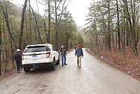 NWA Democrat-Gazette/FLIP PUTTHOFF<br />Hikers return to their vehicle after scrambling down an incline Feb. 23 2018 to see a roaring cascade along Falling Water Creek.