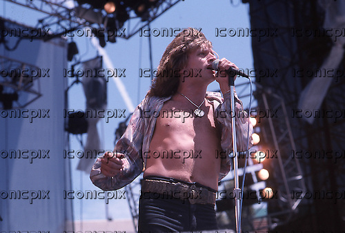 Kingdom Come - vocalist Lenny Wolf - performing live on the Monsters of Rock Tour of the USA at the Memorial Coliseum in Los Angeles USA - July 24, 1988.  Photo Credit : David Plastik/ IconicPix