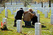Unidentified people mourn on Veteran's Day, beside gravestones in Section 60 of Arlington National Cemetery, in Arlington, Virginia, USA, 11 November 2012. US President Barack Obama visited Section 60, 11 November, which is the final resting place for the majority of casualties at Arlington National Cemetery that died from Operation Iraqi Freedom in Iraq and Operation Enduring Freedom in Afghanistan..Credit: Michael Reynolds / Pool via CNP