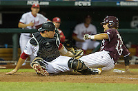 Mississippi State second baseman Brett Pirtle (13) slides safely home as Indiana Hoosiers catcher Kyle Schwarber (10) attempts to tag him during Game 6 of the 2013 Men's College World Series on June 17, 2013 at TD Ameritrade Park in Omaha, Nebraska. The Bulldogs defeated Hoosiers 5-4. (Andrew Woolley/Four Seam Images)