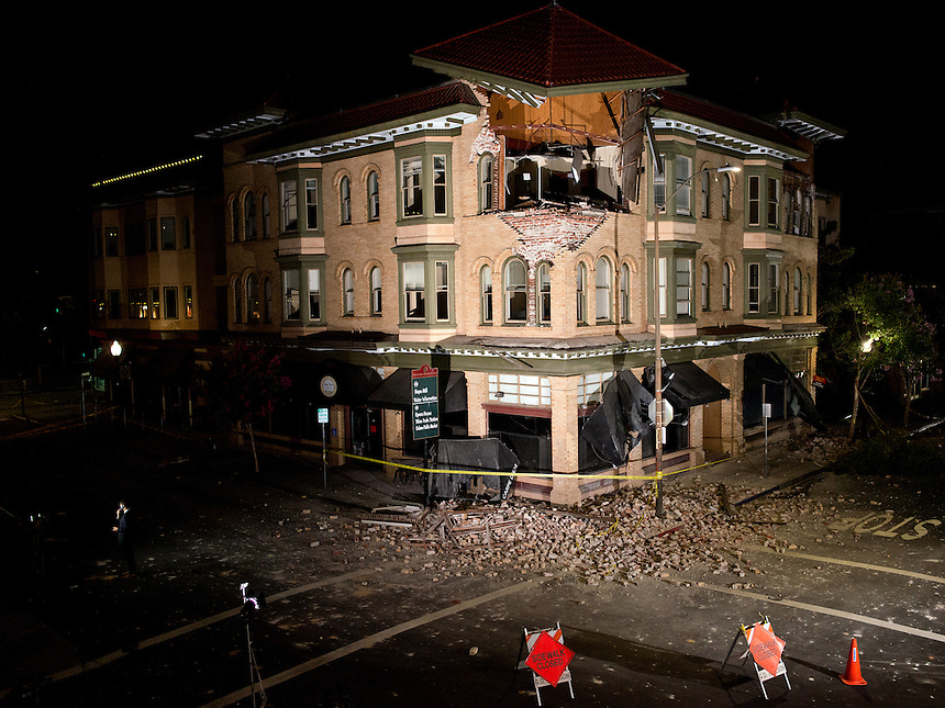 A damaged building at the corner of Brown Street and Second Street after a 6.1 magnitude earthquake hit the San Francisco Bay Area at 3:20 am, in Napa, California, USA, 24 August 2014. More than 70 people were sent to hospital with injuries and power outages darkened multiple cities in northern California after a 6.1-magnitude earthquake struck early on 24 August. The United States Geological Survey (USGS) said the earthquake struck at 3:20 am (1020 GMT) at a depth of 10.8 kilometres. It was located nine kilometres south-west of the Napa wine region, and 81 kilometres north of San Francisco.