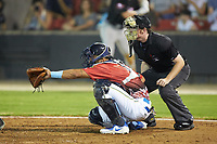 South Division catcher Jhonny Pereda (15) of the Myrtle Beach Pelicans sets a target as home plate umpire Austin Jones looks on during the 2018 Carolina League All-Star Classic at Five County Stadium on June 19, 2018 in Zebulon, North Carolina. The South All-Stars defeated the North All-Stars 7-6.  (Brian Westerholt/Four Seam Images)