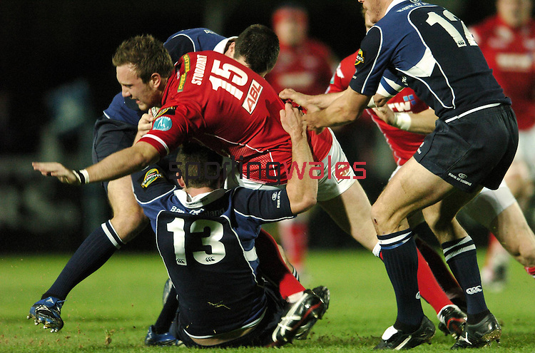 5 October 2007; Morgan Stoddart, Llanelli Scarlets, is tackled by Fergus McFadden, 13, and Jonathan Seston,  Leinster. Magners League, Leinster v Llanelli Scarlets, RDS, Ballsbridge, Dublin. Picture credit; Matt Browne / SPORTINGWALES.05.10.07.©Steve Pope.Sportingwales.The Manor .Coldra Woods.Newport.South Wales.NP18 1HQ.07798 830089.01633 410450.steve@sportingwales.com.www.fotowales.com.www.sportingwales.com