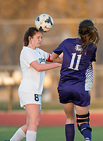 NWA Democrat-Gazette/BEN GOFF @NWABENGOFF<br /> Madison Howard (8) of Bentonville wins a header against Regan Resz (11) of Fayetteville Tuesday, March 13, 2018, during the match at Bentonville's Tiger Athletic Complex.