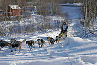 Saturday, February 24th, Knik, Alaska.  Jr. Iditarod musher Ellen King on the trail shortly after leaving the Knik start