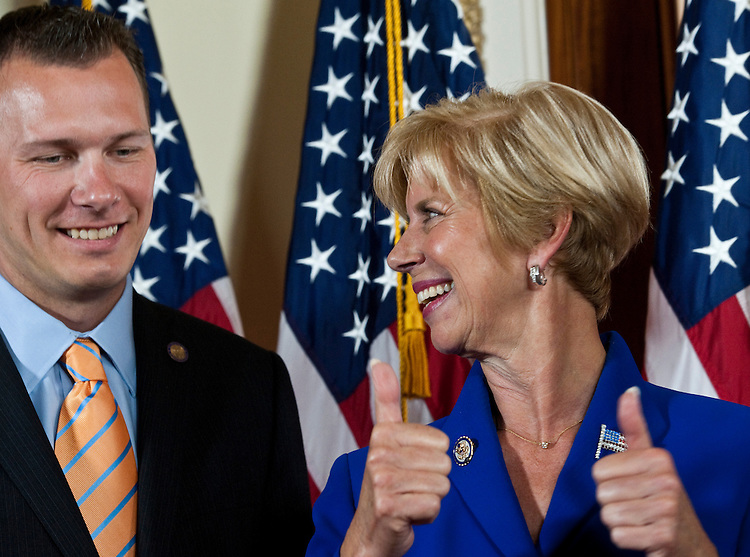 WASHINGTON, DC - July 19: Newly sworn-in Rep. Janice Hahn, D-Calif., gives a thumbs up to son-in-law John Yates after a mock swearing in for the media with House Speaker John A. Boehner, R-Ohio, at the U.S. Capitol. (Photo by Scott J. Ferrell/Congressional Quarterly)