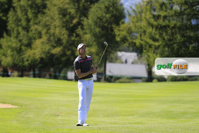 Brett Rumford (AUS) plays his 2nd shot on the 15th hole during Saturday's Round 3 of the 2014 Omega European Masters held at the Crans Montana Golf Club, Crans-sur-Sierre, Switzerland.: Picture Eoin Clarke, www.golffile.ie: 6th September 2014