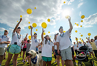 NWA Democrat-Gazette/BEN GOFF @NWABENGOFF<br /> Stuart Scott (from left), daughter Daphne Scott, wife Melanie Scott, daughter Sophia Scott, daughter-in-law Julie Scott, and son Trey Scott of Fayetteville take part in a balloon release Sunday, Sept. 10, 2017 during the 4th annual Northwest Arkansas Out of the Darkness Community Walk at Orchards Park in Bentonville. Held on World Suicide Prevention Day, the walk is a fundraiser supporting the Arkansas Chapter of the American Foundation for Suicide Prevention. This year 552 walkers raised more than $42,000, according to Nikki Nance, walk chair with the chapter. The Scott family, with help from co-workers from J.B. Hunt Transport, were the leading fundraisers this year, walking in memory of daughter/sister Alex Scott.