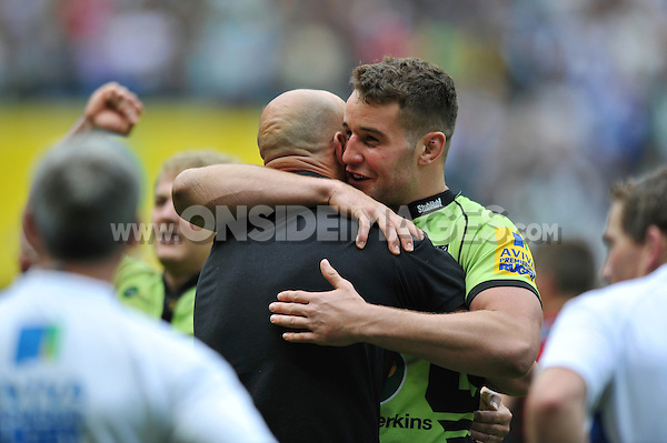 Calum Clark embraces Northampton Saints Head Coach Jim Mallinder after the final whistle. Aviva Premiership Final, between Saracens and Northampton Saints on May 31, 2014 at Twickenham Stadium in London, England. Photo by: Patrick Khachfe / JMP