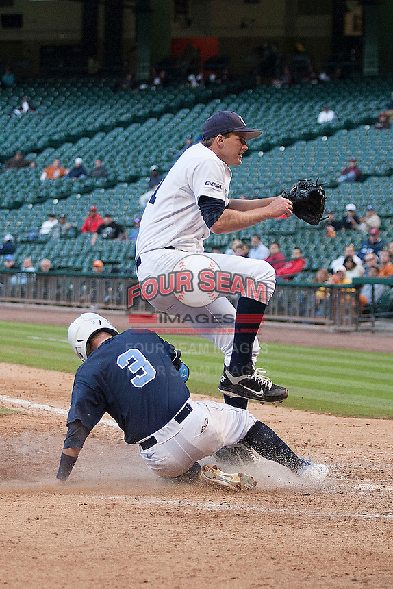 Rice Owls starter Austin Kubitza #21 jumps away from the sliding Mike Zolt #3 in the second inning of the NCAA baseball game against the North Carolina Tar Heels on March 1st, 2013 at Minute Maid Park in Houston, Texas. North Carolina defeated Rice 2-1. (Andrew Woolley/Four Seam Images).