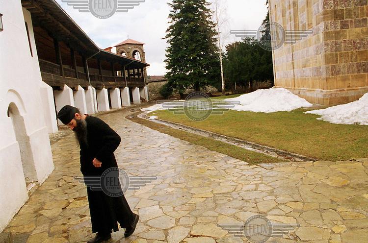 © Andrew Testa / Panos Pictures..KOSOVO. A monk at Decane monastery.