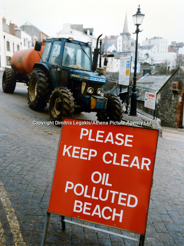 Pictured: A warning sign in Tenby, west Wales<br /> Re: The Sea Empress oil spill occurred at the entrance to the Milford Haven Waterway in Pembrokeshire, Wales on 15th February 1996 which was followed up by a clean up operation has begun