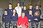 The children from Scoil Bhreanainn Portmagee who made their Confirmation in St Michael the Archangel Church Ballinskelligs on Tuesday last pictured here front l-r; Gavan de Silva, Clodagh O'Shea, Canon Billy Crean, Gavan Riordan, Sean O'Sullivan, back l-r; Lukas Paulaskaus, Karen Stenson(Teacher), Tara Riordan, Daniel O'Sullivan, Padraic O'Connell.